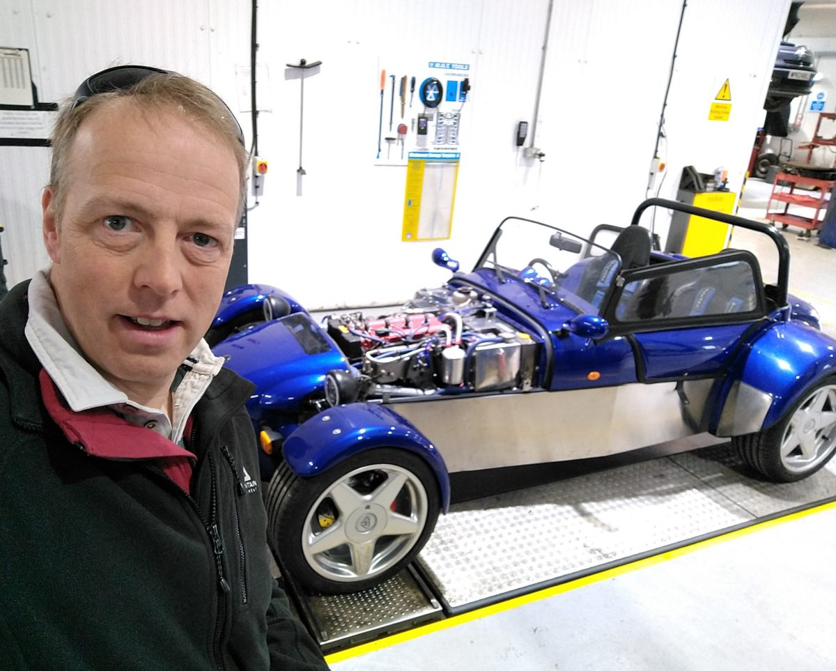 Clem Robertson, CEO of R4dar Technologies, with his Cosworth-powered Quantum sportscar