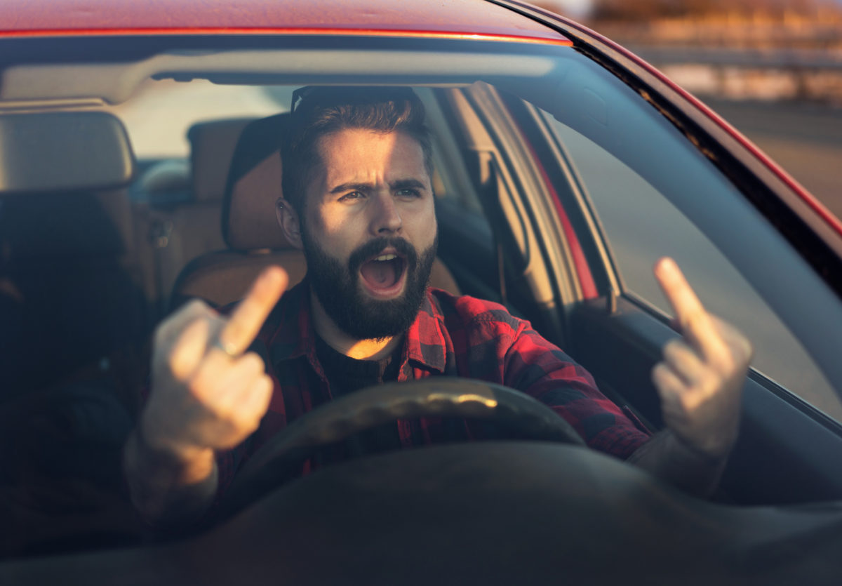 Driver flipping the bird (via iStock)